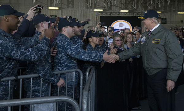 President Donald Trump greets sailors after entering the hangar bay aboard Pre-Commissioning Unit Gerald R. Ford in March. (Mass Communication Specialist 3rd Class Cathrine Mae O. Campbell/Navy)
