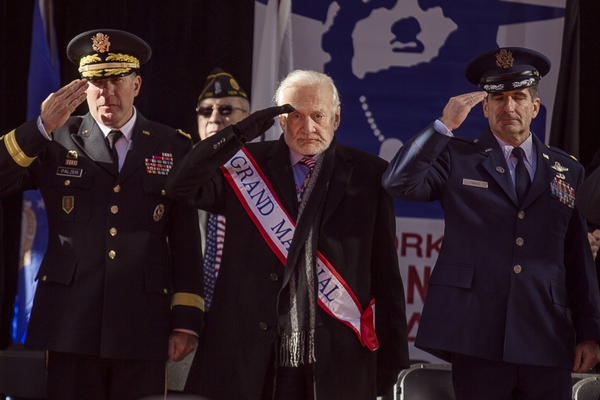 Former astronaut Buzz Aldrin, center,salutes during the annual Veterans Day parade in New York, Saturday, Nov. 11, 2017. Aldrin served as Grand Marshal as he joined Mayor Bill de Blasio and others at the city's parade. (Andres Kudacki/AP)